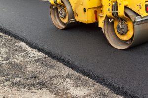 finishing a new asphalt road in arlington va